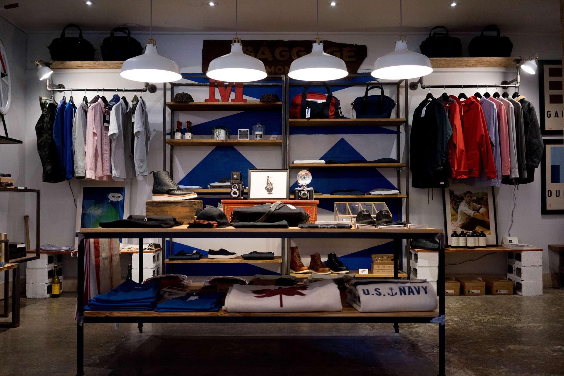 A retail boutique with clothing, shoes, and decor items displayed.